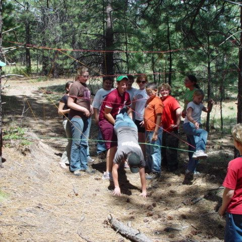 Youth group doing a team building activity at camp