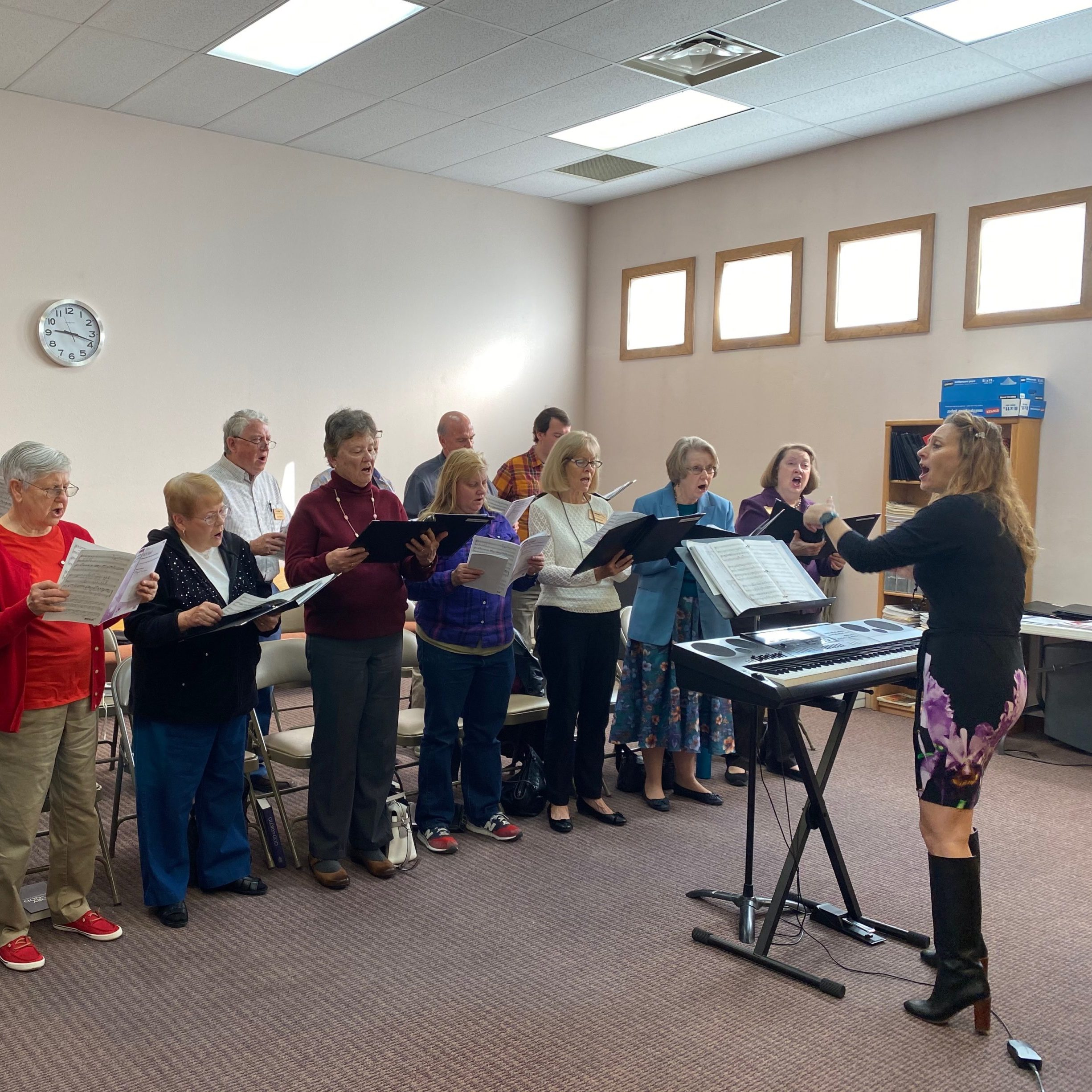 Choir rehearsing before worship with music director Deborah Mhoon